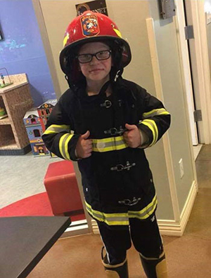 Aidan dressed as a fire fighter