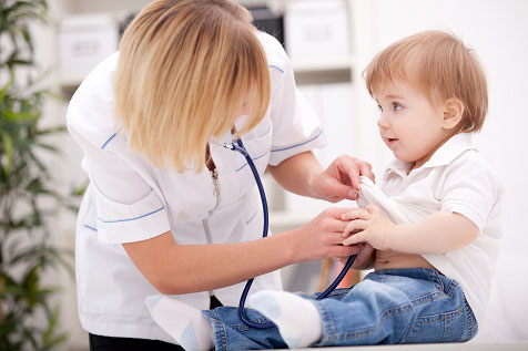 doctor checking toddlers heart beat with stethoscope