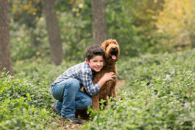 Easton and his dog in a field