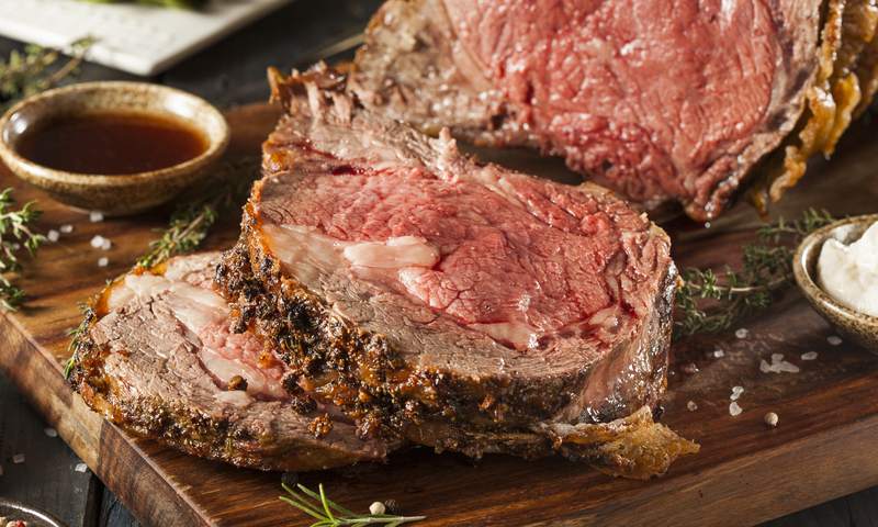 Sliced prime rib on a cutting board