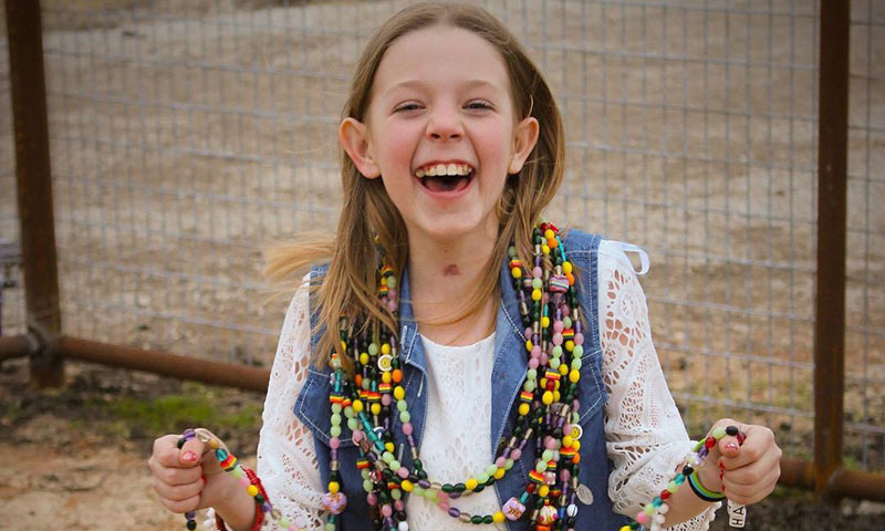 Hanna with beads round her neck
