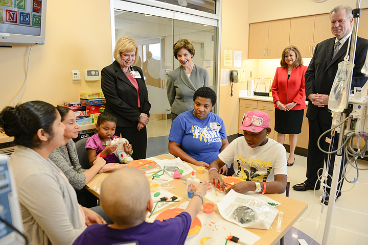 former first lady gathering around table with kids