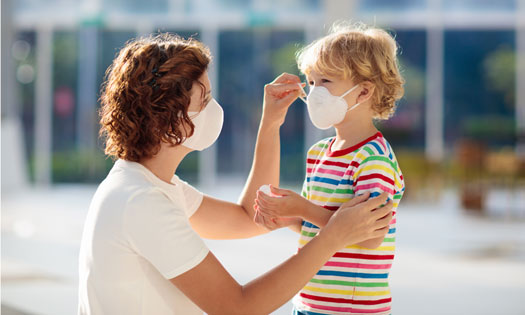 Mom helping child with facemask