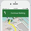 teléfono celular que muestra instrucciones de navegación en la aplicación de Children's Health℠