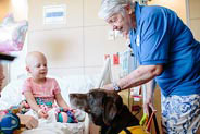 pet therapy volunteer visits patient in her room
