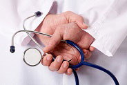 hands holding stethoscope