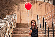patient image of Raelyn holding red balloon