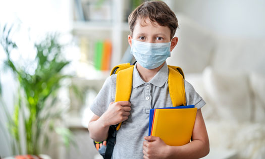 Boy going to school with mask on