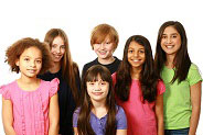 diverse group of kids smiling against white backdrop