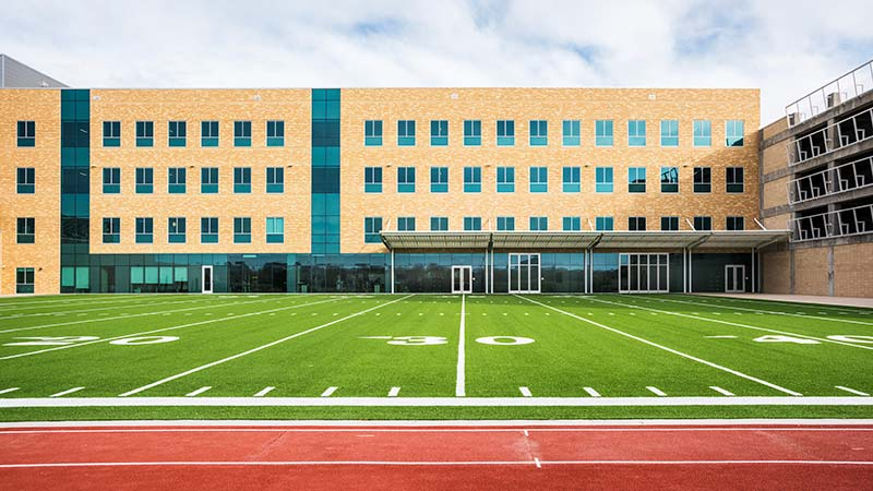 60 yard turf field next to Children's Health Specialty Center 2 building used for sports training and drills.