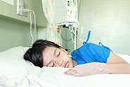 patient sleeping in hospital bed