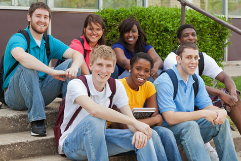 group of teens sitting outside of school on staircase