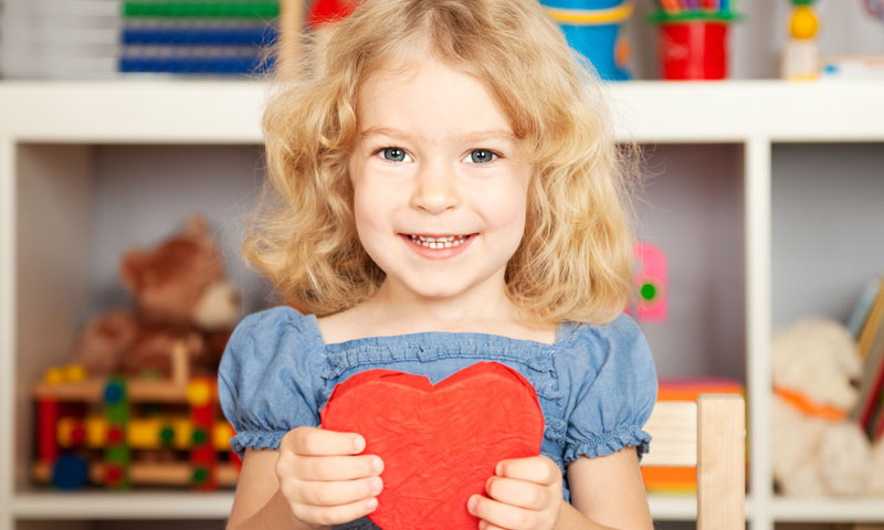 Little girl holding valentine heart