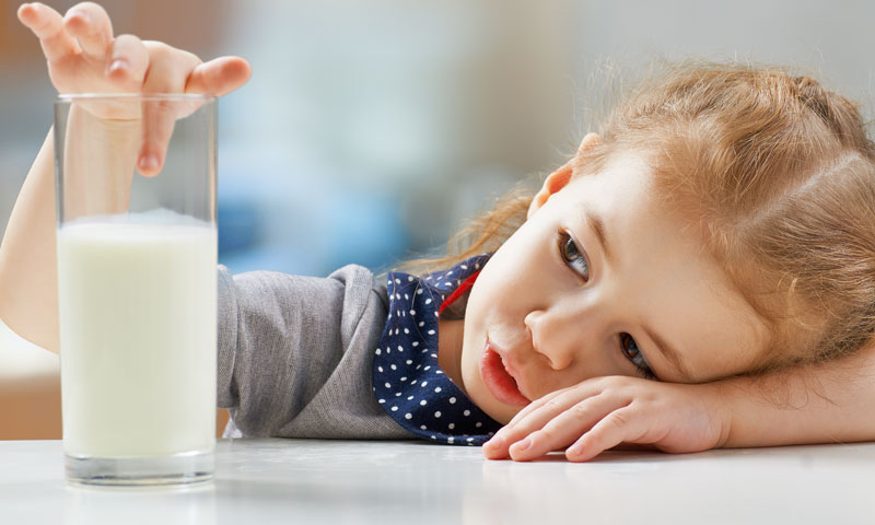 Little girl with milk