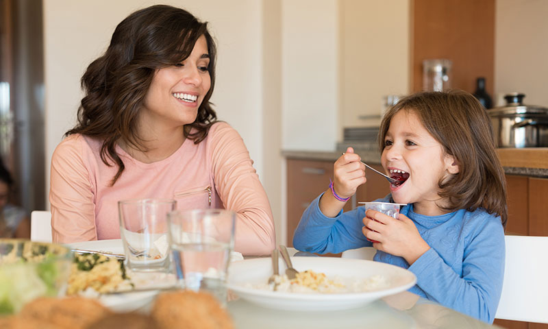 mother and daughter eating healthy meal together