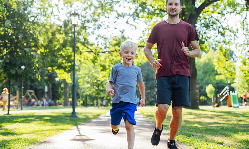 Father and son running in the park