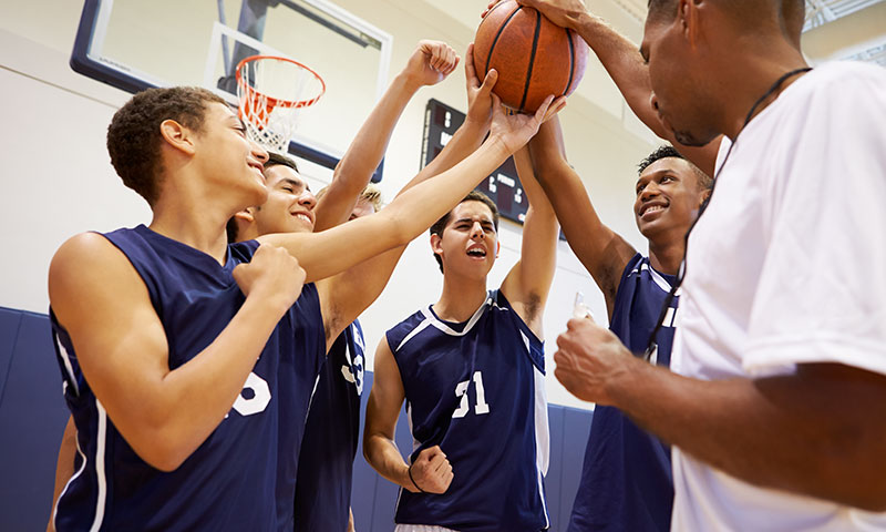 Boys basketball team huddle