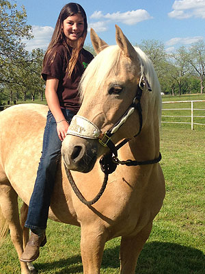 image of patient Keely riding her horse