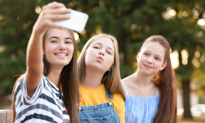 Three young girls taking a selfie together