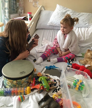 Camilla with a Children's Health Music therapist