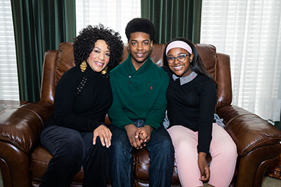 Aldorsey with his mother and sister