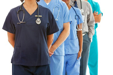doctors from neck down standing in a row