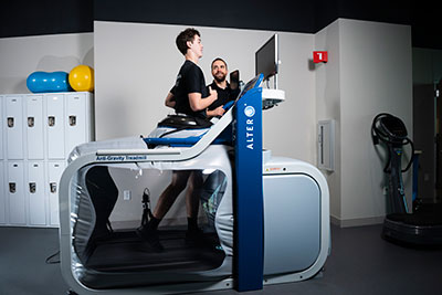 Jack on treadmill with trainer