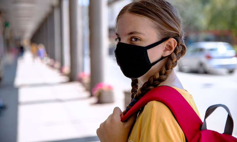 Teen with mask