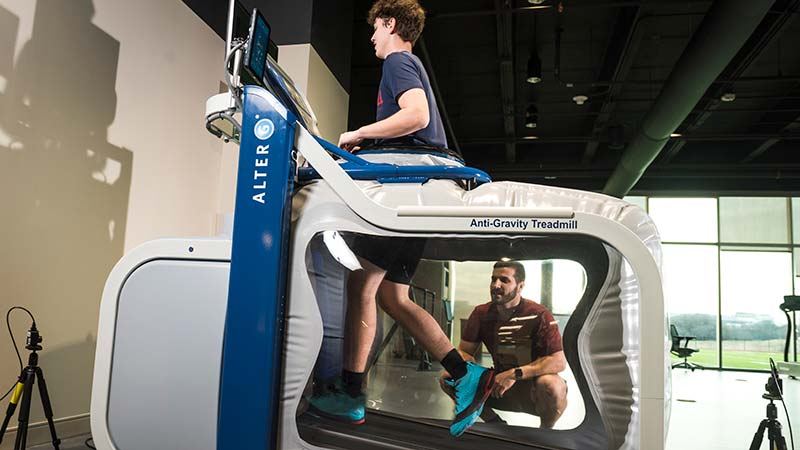 Young athlete running on the Alter-G treadmill, which lets him run without increased weight to his joints and muscles.