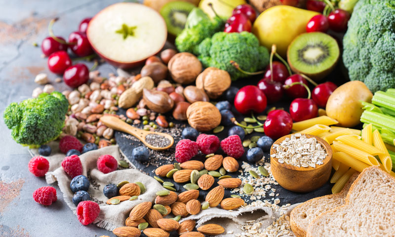 fruits, veggies, nuts, and grains on a table